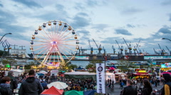 Harbor and funfair with ferris wheel in the evening timelapse Stock Footage