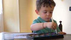 portrait of little boy painting with watercolors - stock footage