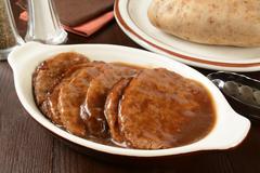 Salisbury steak in casserole Stock Photos