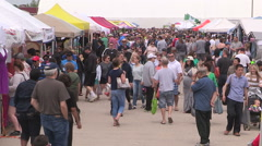 Busy and crowded farmers and crafts market on warm summer day Stock Footage