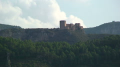 Castle in the mountains with cloud developing Stock Footage