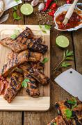 Grilled Spareribs in spicy marinade with beer and rustic bread Stock Photos