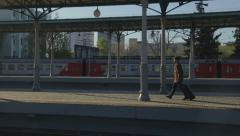 Business man walking along the railway station in slow motion Arkistovideo