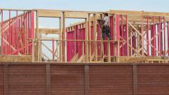 Construction Worker Framing Houses Stock Footage