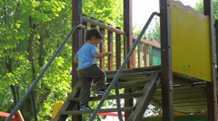child having fun in playground - stock footage