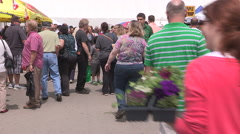 Busy and crowded farmers and crafts market on warm summer day - stock footage