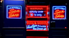 Neon signs in a sex shop Stock Footage