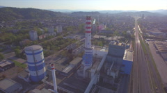 AERIAL: Flying over big chimney in heating plant Stock Footage
