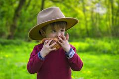 Adorable child with croissant Stock Photos