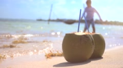 Coconuts on shore - stock footage