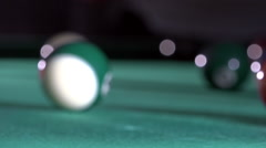 Billiard, pool table, slow motion, the white ball hits the green ball 12/15 Stock Footage