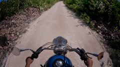 Riding motorcycle in sand road Stock Footage