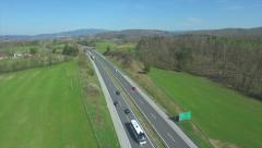 AERIAL: Cars and trucks speeding on the highway - stock footage