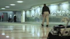 Hospital Corridor with patients and visitors Stock Footage