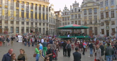 The Grand Place central square in Brussels city Belgium carousel people crowd  Stock Footage
