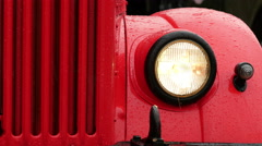 Old-fashioned car in the rain Stock Footage