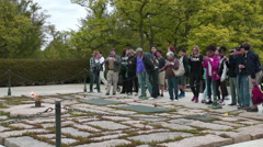 Visitors at the Eternal Flame at the JFK Memorial Stock Footage