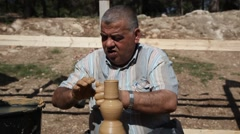 Arab Israeli makes old village style pottery pitcher Stock Footage