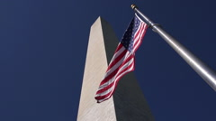 American Flag Waving  & George Washington Monument - stock footage