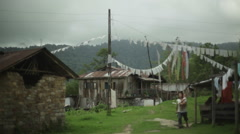 Woman and baby in Himalaya village, long shot, shallow focus Stock Footage