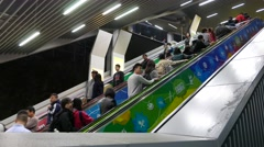 Escalators full of people travelling up and down, passage from Yau Tong MTR - stock footage