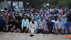 Arab Israelis pray during Nakba Day or Day of Catastrophe, a commemoration - stock footage