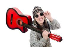 Stock Photo of Young optimistic girl holding guitar isolated on white