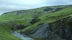 Green Icelandic Hillside and River Valley ICELAND Stock Footage