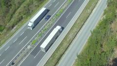 AERIAL: Truck transporting the cargo on a highway Stock Footage