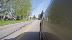 Vehicle traveling over school zone markings on road Stock Footage