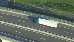 AERIAL: Freight truck transporting cargo over highway viaduct Stock Footage