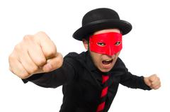 Young man with red mask isolated on white - stock photo