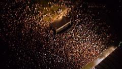 AERIAL: Crowd of people dancing on a music festival Stock Footage