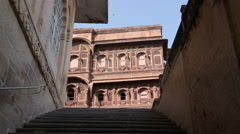 Child walking up the stairs to indoor building of Mehrangarh fort. Stock Footage