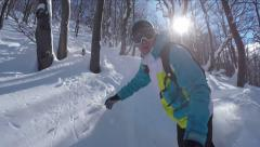 SELFIE: Snowboarder riding powder snow in sunny winter - stock footage