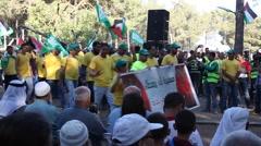 Arab Israelis parade during Nakba Day, a commemoration - stock footage