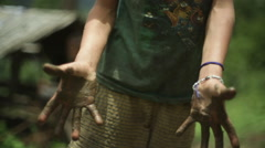 Himalaya village boy muddy hands, India, medium shot, shallow focus Arkistovideo