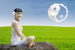 Happy girl and ying yang cloud outdoor - stock photo