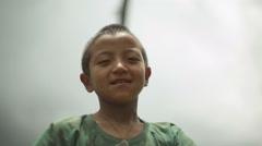 Himalaya village boy, Sikkim India, medium shot, shallow focus Stock Footage