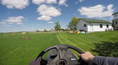 4k lawn tractor chest pov Stock Footage