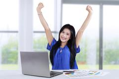 Woman celebrates her accomplishment - stock photo
