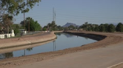 Desert Water Canal 09 with multiple people exercising alongside Stock Footage