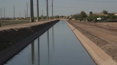 Desert water canal 10 - truck rides by Stock Footage