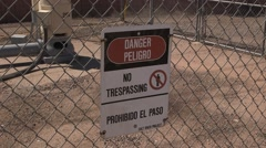 Danger no tresspassing sign protecting an electrical sub-station Stock Footage