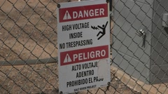 Stock Video Footage of Danger high voltage sign protecting an electrical sub-station 02
