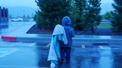 Dragging Blanket in the rain. Stock Footage