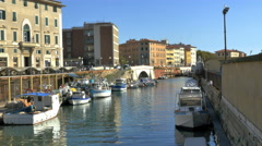 Boats moored along canal Livorno, Italy passing street traffic - 4K UHD 0661 - stock footage