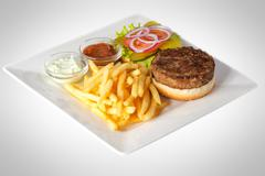 Hamburger with French Fries and Sauce Stock Photos