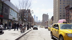 Panning shot of Freedom Tower, cars taxi cab, traffic, 6th Ave Manhattan 4K NYC Stock Footage