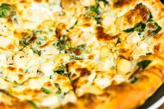 Chicken pine nut pizza - stock photo